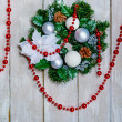 Christmas wreath and red garland decoration — Stock Photo
