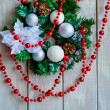 Christmas wreath and red beads decoration — Stock Photo
