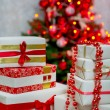 Gift boxes by the Christmas tree — Stock Photo