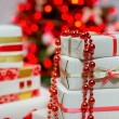 Gift boxes and Christmas tree lights — Stock Photo #36084561