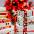 Gift boxes and Christmas tree lights — Stock Photo