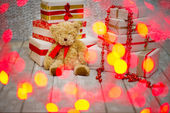 Gift boxes and teddy bear — Stock Photo