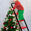 Kid decorating Christmas tree — Stock Photo