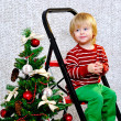 Toddler and decorated Christmas tree — Stock Photo