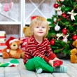 Smiling kid and Christmas presents — Стоковое фото