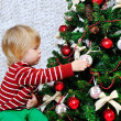 Little boy decorating Christmas tree — Stock Photo