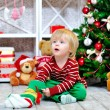 Cute toddler and Christmas present — Stock Photo