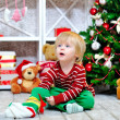Cute toddler and Christmas present — Stock Photo #36601699