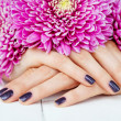 Hands with manicure and pink flower — Stok fotoğraf