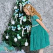 Beautiful blonde girl and Christmas tree — Stock Photo