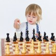 Cute little boy playing chess — Stock Photo