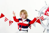 Positive fashion kid as a sailor — Stock Photo