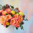 Beautiful flower bouquet with orange roses and yellow ranunculus — Stock Photo #41083631