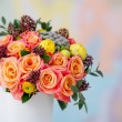 Beautiful flower bouquet with orange roses and yellow ranunculus — Stock Photo