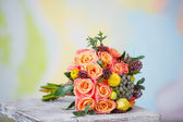 Wedding bouquet with beautiful orange roses and yellow ranunculus — Stock Photo
