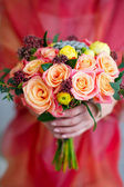 Woman hands holding flower bouquet — Stock Photo