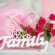 Pink flowers and family sign — Stock Photo #44559547