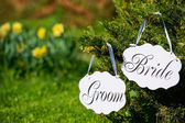 Wedding bride and groom boards outdoors — Stock Photo