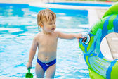 Adorable toddler in the swimming pool — Stock Photo