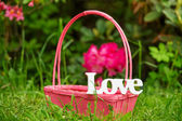 Love decoration word in the garden — Stock Photo