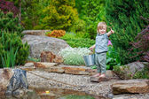 Cheerful kid angling — Stock Photo