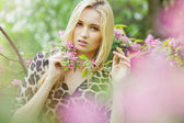 Young attractive woman in blooming spring trees — Stock Photo