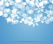 Blue snowflakes background — Stok Vektör