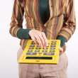 Stock Photo: Executive with calculator