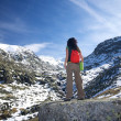 Trekking woman at a snow valley — Stock Photo