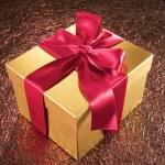 Golden gift on sparkling background — Stock Photo #14081506