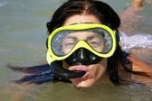 Snorkeling woman outside water — Stock Photo
