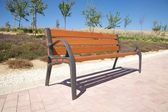 Side wooden bench — Stock Photo