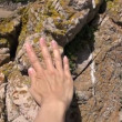 Woman hand caressing rock beach — 图库视频影像