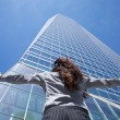 Businesswoman adoring crystal skyscraper — Stock Photo