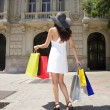 Foto Stock: Walking with shopping bags