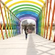 Walking at colorful footbridge — Foto Stock