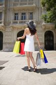 Walking with shopping bags — Stock Photo