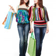 Stock Photo: Two young women with shopping bags