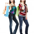 Two young women with shopping bags — Stock Photo #12371894