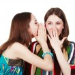 Two happy young girlfriends make gossip — Stock Photo #12371910
