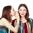 Two happy young girlfriends make gossip — Stock Photo #12371912