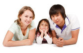 Casual portrait of a healthy, attractive young family — Stock Photo