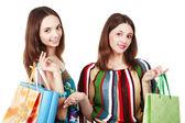 買い物袋を持つ 2 つの若い女性 — ストック写真
