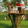 Cute small tree house for kids on backyard. — Stock Photo