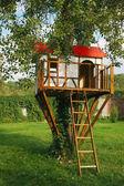 Cute small tree house for kids on backyard. — Stock Photo
