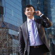 Young businessman talking on mobile phone. — Stock Photo #13785960