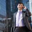 Young businessman talking on mobile phone. — Stock Photo #13785998