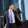 Young businessman talking on mobile phone. — Stock Photo #13786028