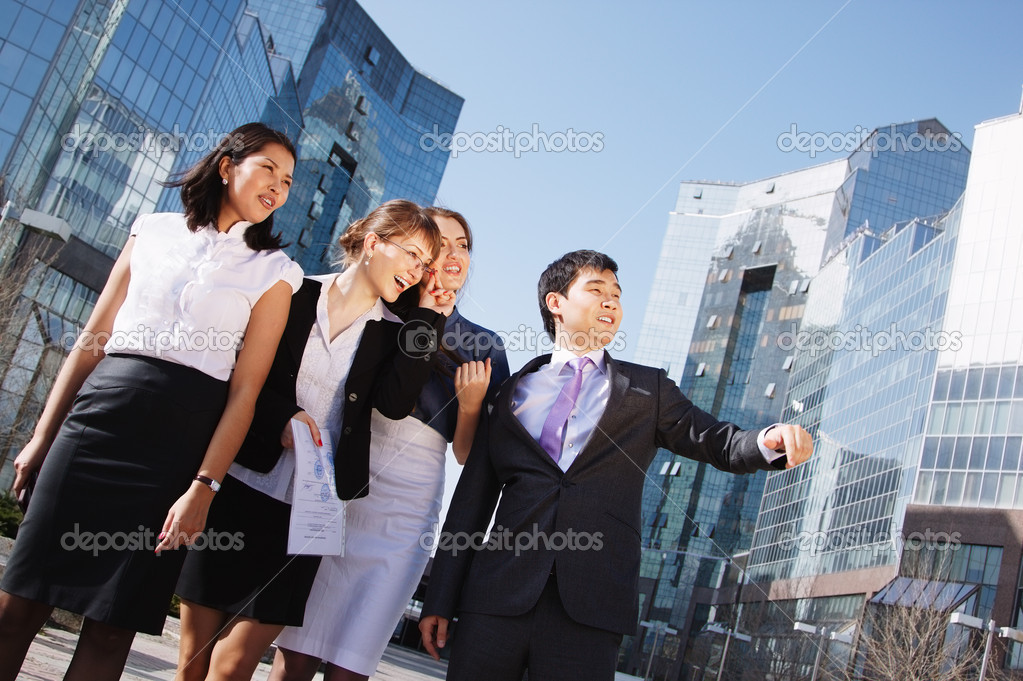 Happy diverse group of executives pointing over business center. Outdoor — Stock Photo #15840045