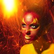 Bright flamy fairy lady fantasy make-up. - Zdjcie stockowe